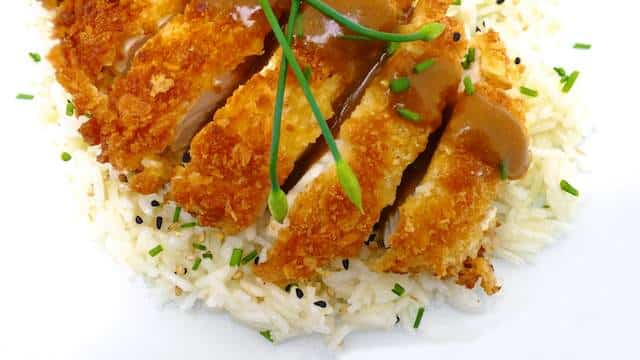 Japanese chicken katsu or crispy panko fried chicken accompanied by a lovely curry sauce and served over a bowl of steaming rice... to die for!