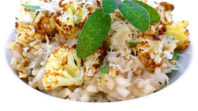 A hearty cauliflower risotto for tonight's dinner! A simple risotto full of autumn flavors: roasted cauliflower, walnuts, sage, and parmesan cheese.