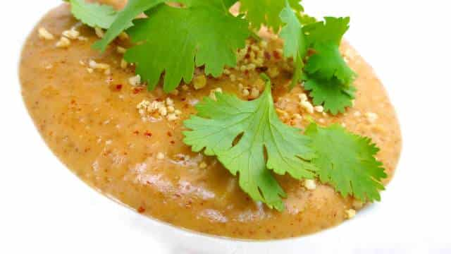 The best peanut sauce recipe ever... you will love the red curry paste in it, gives this creamy sauce so much more flavor and depth!