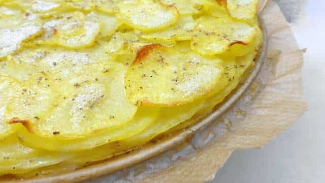 A classic French potato galette recipe: crunchy scalloped potatoes on top, buttery soft and smooth potatoes underneath...
