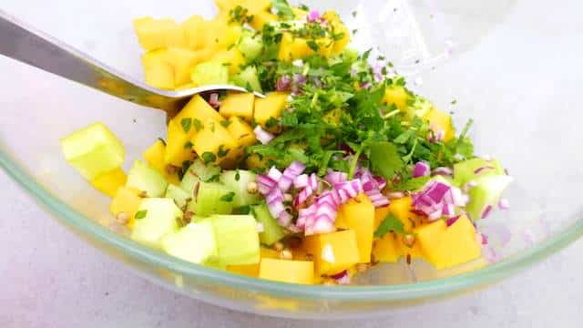 Here's my crunchy shrimp tacos recipe with grilled shrimp and a fresh cucumber, chopped cilantro and a sweet mango salsa...