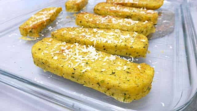 Try this very easy grilled polenta: with pine nuts, black olives and grated parmesan cheese... Serve it as a light lunch or a veggie side dish!