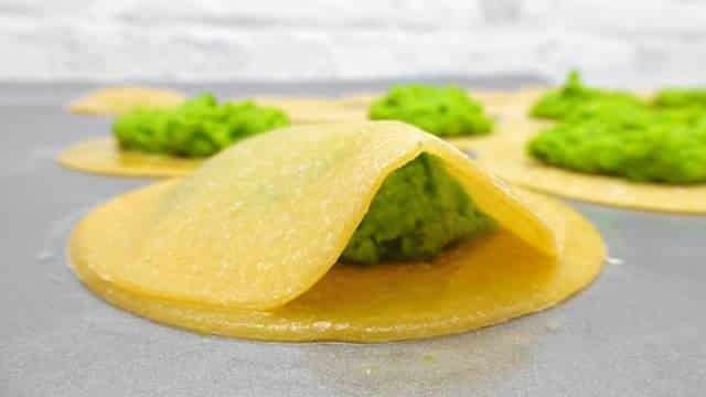 My homemade ravioli recipe: a fresh ravioli recipe with peas and a surprising fresh twist of mint. Learn how to make fresh pasta!