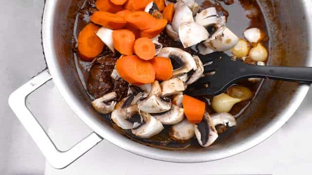 Here is a classic beef bourguignon recipe: try this traditional French beef stew with pearl onions and mushrooms at home!