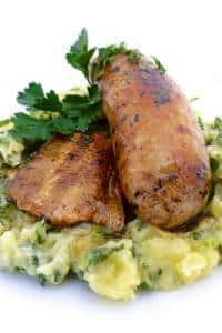 My Flemish stoemp: creamy savoy cabbage potato mash with baked sausage and bacon... Good old-fashioned Belgian comfort food!