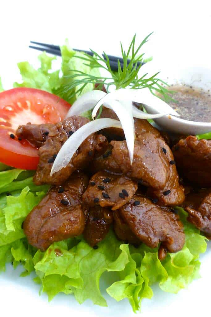 Try this traditional Cambodian beef lok lak: stir fried beef strips with soy sauce served with lettuce and tomatoes... Yum!