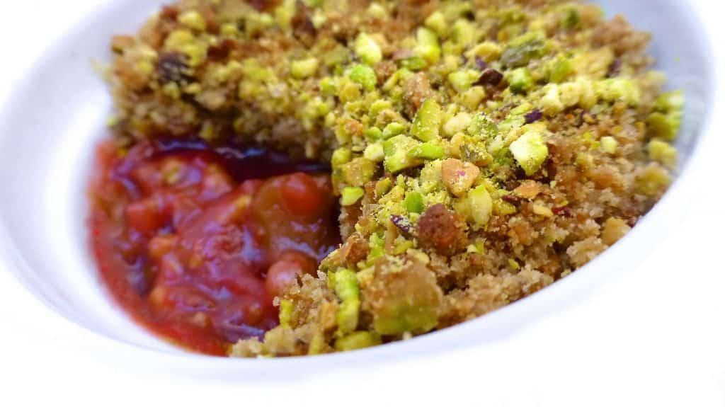 Rhubarb crumble recipe: sugary smooth rhubarb and strawberry tomato jam topped with a crunchy salted pistachio crumble!