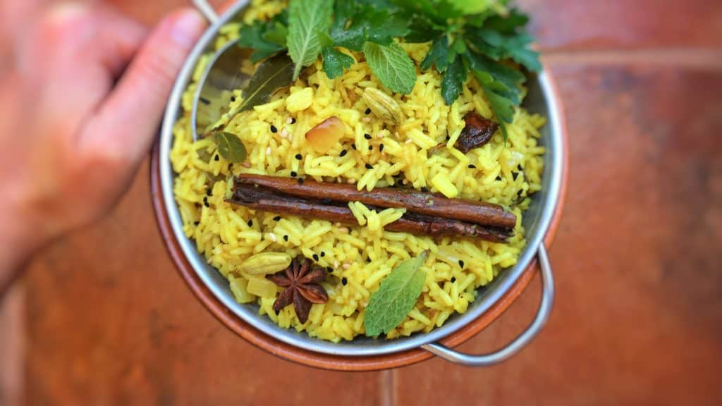 Buttery golden rice with fried onion and flavorful spices such as turmeric, clove, cinnamon and star anise: you will adore my super easy pilau rice recipe!