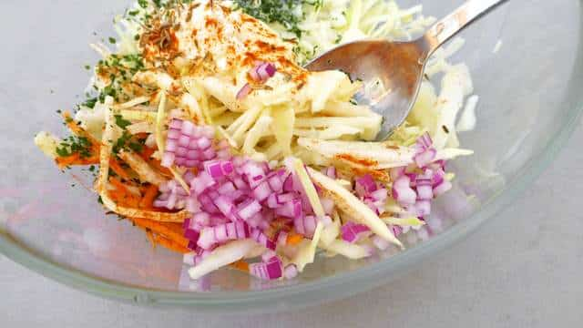 My super crunchy baked salmon taco recipe with a fresh and homemade cabbage slaw, creamy avocado and chopped cilantro... Delish!