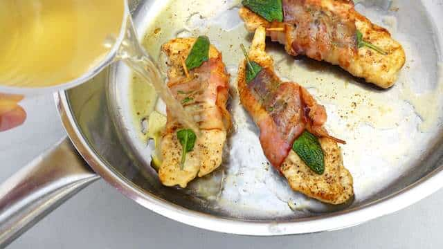 My classic chicken saltimbocca recipe: a traditional Italian recipe with prosciutto wrapped chicken in a light white wine sauce!