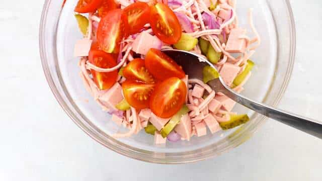 Classic Bavarian wurstsalat, a German bologna sausage salad with cherry tomatoes, vinegar, red onion and pickled gherkins!