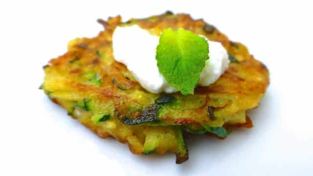 I love to these zucchini fritters as an easy appetizer recipe topped with a little smoked salmon and a drop of sour cream...