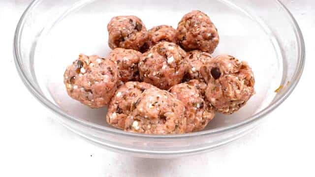 Make ahead oven-baked lamb meatball appetizer with feta cheese and black olives! Or serve them as a main course with fresh lettuce and tzatziki sauce!