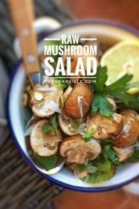My raw mushroom salad recipe: an easy salad of raw mushrooms with a lemony olive oil dressing, fresh mint, pumpkin seeds and parmesan cheese!