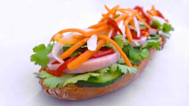 Vietnamese banh mi sandwich with sausage, mint, coriander, cucumber, carrots, spring onion and mayonnaise... great lunch idea!
