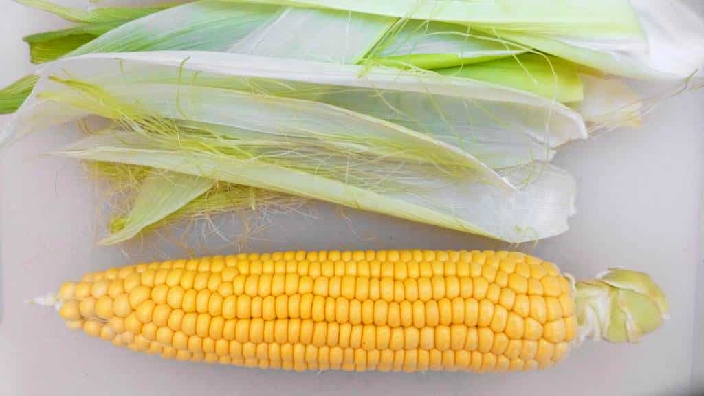 Rain, sun or snow: corn on the cob with cilantro butter always tastes great! This is an amazingly flavorful side dish recipe!