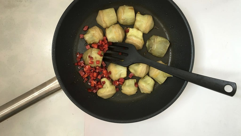 Pan fried artichokes in white wine sauce with dried chorizo sausage and fresh parsley! This is a great side dish for grilled steaks...