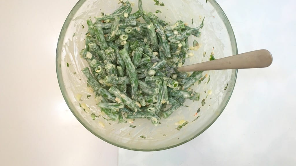 It's BBQ time! This chopped green bean salad in garlic cream cheese dressing is the perfect match for grilled steak or wings!