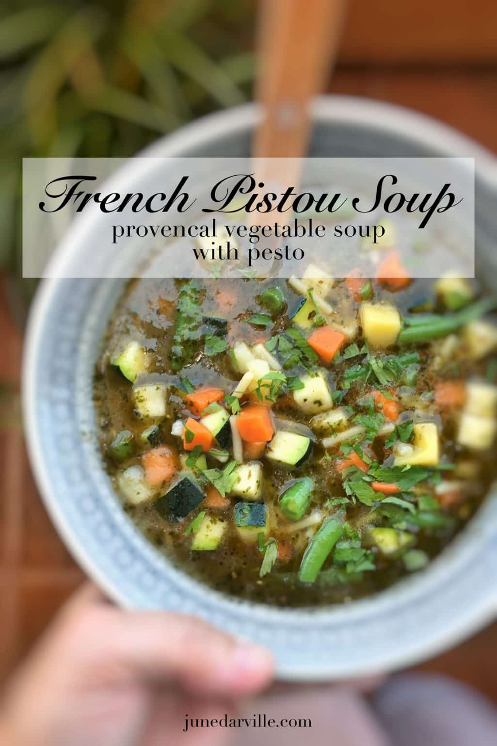 French pistou soup: a provençal chunky vegetable soup with peas, green beans, potatoes, zucchini and a spoonful of basil pesto...