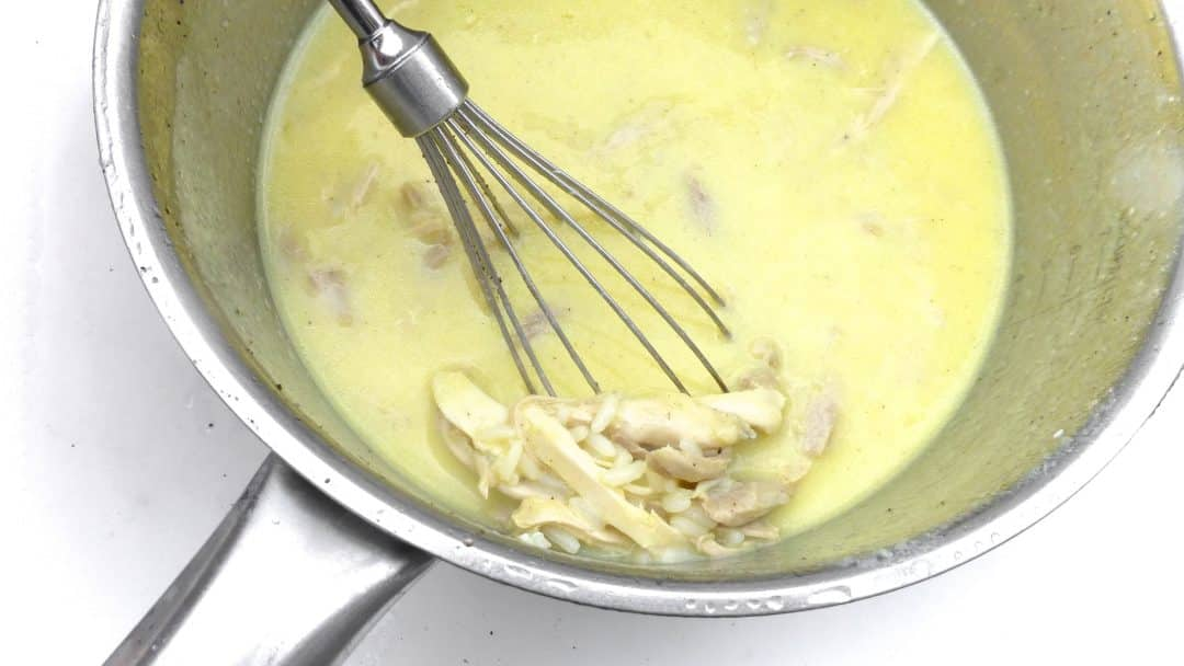 Craving soup on a hot summer's day? This refreshing Greek lemon and egg soup with chicken aka avgolemono soup recipe is what you need!