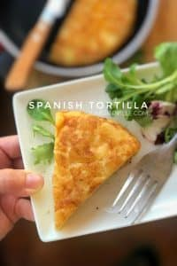 Spanish tortilla recipe: the famous classic Spanish omelette with potatoes and onions! This recipe is just perfect, never fails!